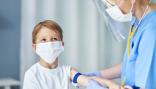 Young boy looking up at a nurse.